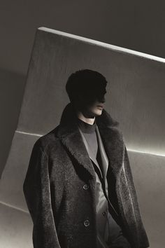 Hermès Fall-Winter 2014. Straight coat in brown shearling, straight evening jacket with slit pockets in khaki wool and silk with fi ne ribs, straight shirt with high collar and shoulder buttons in khaki cotton poplin, trousers with cut-out in brown wool canvas and mohair #hermes #menswear #fashion #hermeshomme