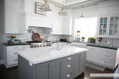 The perfect example of what I want the kitchen to resemble including the floors, but minus the gray painted cabintry