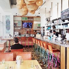 Blue Plate Taco | Santa Monica, CA...love the back wall with the shelves & the different color shutter cabinet doors..