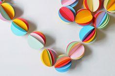 http://www.aprettycoollife.com/2014/08/diy-rainbow-circle-punch-garland.html