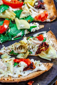 15-minute Artichoke Garden Flatbread Pizza | The Mediterranean Dish. Mediterranean-style flatbread pizza with artichokes, tomatoes, olives, feta and more! With ready low-carb, high fiber Flatout® Flatbread!