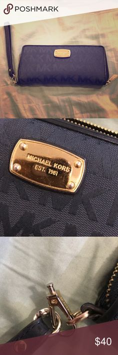 Michael Kors Jet Set Travel Zip Around  Wallet Travel Wallet - Navy Blue Canvas in good condition.metal clasp went loose as shown in picture so its attached by the wallets own hook. Still works great! Michael Kors Bags Wallets