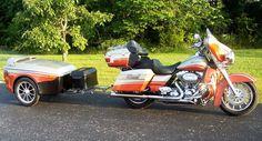 Harley orange motorcycle trailer.