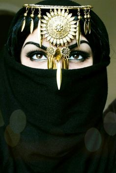 Angelica Meskhia golden head piece burka