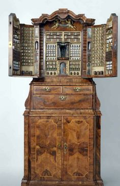 Apothecary's Cabinet, 1730, Delft,  Veneered with walnut and olive wood in oak core. Contents complete with a myriad of porcelain and glass containers. Rijksmuseum