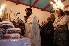 In the midst of a liturgy inside the Church of St. Constantine. The artos bread, which people bring to church as an offering, is blessed by the priest, then eaten after the service.