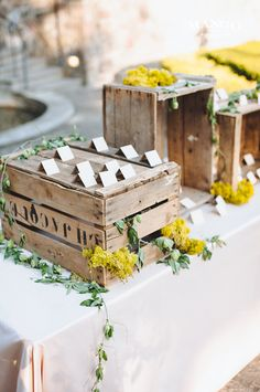 individual escort cards displayed on vintage rustic wooden crates