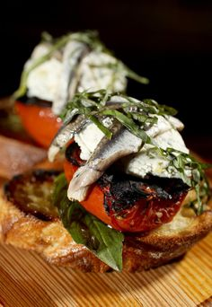 Brick & Mortar's menu includes crostini with toppings such as white anchovies with burned tomato and goat cheese.