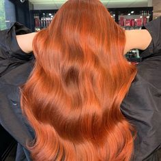 Shiny copper red long waves with lots of beautiful body and bounce. Created by Wella Passionista Sharell Halpine.