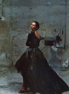 Kate Moss | feather | gown | dress | high fashion | fashion editorial | amazing | model | famous | warehouse shoot | dark | photography |