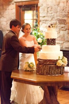 Bride & Groom With Rustic Wedding Cake