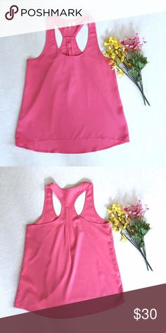 "Pink Flowy Tank Top New never worn! Pink flowy tank top from the brand Frenchi. Length 25"". Chest 16"". Would probably fit a small better. 97% Polyester and 3% Spandex. Frenchi Tops Tank Tops"