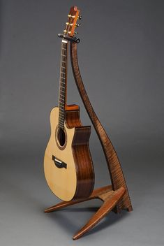 WM Guitar Stand in claro walnut with ebony binding.