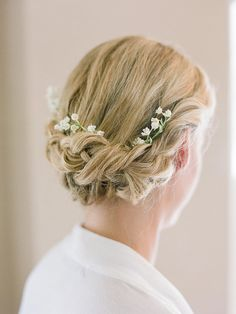 You will look like an angel Tuck a few small blooms into a braided halo wedding hairstyle for a truly angelic look.