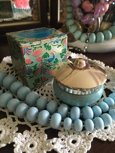 A beautiful vintage 60s Avon Bird of Paradise cream sachet jar still in its box. Ornate detailing on box with blue, pink, green and gold floral and bird designs. The jar is pale blue with a gold lid. Small amount of product still in jar, however due to its age Id suggest this should be
