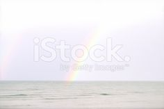 Somewhere over the Rainbow royalty-free stock photo Rainbow Photo, Somewhere Over, Closer To Nature, Over The Rainbow, Image Now, How To Be Outgoing, Royalty Free Stock Photos, Pastel, Beach