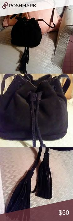 NWT J CREW SUEDE MINI BUCKET BAG! BEAUTIFUL, NWT, NEVER USED! RECEIVED AS A GIFT SEE RECEIPTS IN PHOTO AND TAGS. NEVER GOT AROUND TO USING THIS ONE. ITS A BEAUTIFUL BLACK SUEDE MINI BAG, PERFECT FOR THIS TIME OF YEAR!  IT HAS DRAWSTRING TASSEL DETAIL AND AN INNER FLAP COMPARTMENT TOO! ADJUSTABLE GOLDTONE BUCKLE STRAP. THIS IS SO NICE!GET IT, FOR HALF OF WHAT IT SOLD FOR! J.CREW Bags Mini Bags