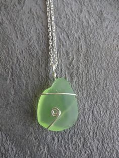 Green Opaque Layered Beach Glass Necklace - Wire Wrapped Sea Glass Necklace - Silver Beach Glass Jewelry -  Beach Glass Swirl Necklace. $14.20, via Etsy.