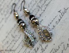 Earrings...Reinvent Seven...by justmeart —Dangling from sterling wires are Vintage Art Deco rhinestone findings, pyrite and garnets