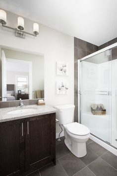 Ensuite with tile flooring, walk-in shower, light granite counters and wood cabinet Light Granite, Tile Flooring, Granite Counters, Walk In Shower, Wood Cabinets, Home Builders, New Homes, House Design, Bathroom