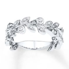 Crafted of sterling silver, this enthralling ring for her features a leafy vine decorated in round diamonds. The ring has a total diamond weight of 1/4 carat. Diamond Total Carat Weight may range from .23 - .28 carats.