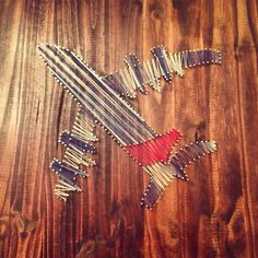 String art airplane for my boyfriend who's a pilot!