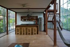 House RR, kitchen with wooden deck and gypsum boards