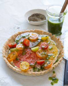 Tomato Tart with Basil Oil and Almond - wonder if I could use this for a pizza crust?