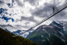 Zermatt, Switzerland: The circular hike to the Randa Suspension Bridge goes through larchwood forests and leads to an imposing record construction: the longest pedestrian suspension bridge in the world. Zermatt, Pont Charles, Clear Lake, Excursion, Pedestrian Bridge, Suspension Bridge, Swiss Alps, Hiking Trails, Scenery