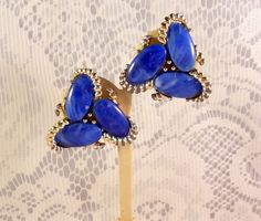 Very interesting and unique earrings by KRAMER. The blue marblized lucite beads are the king of these earrings - they are so interesting with