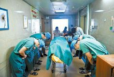 Chinese doctors bowing down to an 11 year old boy diagnosed with brain cancer who managed to save several lives by donating his organs to the hospital he was being treated shortly before his death.