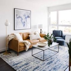 Want to use minimalism in your living room? From investing in quality furniture to taking advantage of natural light, we show you how to design a minimalist living room in this guide! Living Room Sofa, Apartment Living, Living Room Decor, Minimalist Living, Modern Living, Living Room Inspiration, Living Room Designs, Tan Couches, Tan Leather Couches