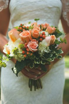 Gorgeous bouquet of roses, hydrangeas, berries, and hosta leaves! {Amanda Sutton Photography}
