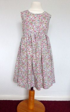 A personal favourite from my Etsy shop https://www.etsy.com/uk/listing/241798867/little-girls-floral-dress-age-3-4-years