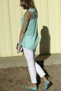 Turquoise top with a white capri, chartreuse necklace and matching turquoise shoes..