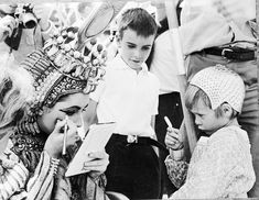 Elizabeth Taylor with kids on Cleopatra set......Uploaded By  www.1stand2ndtimearound.etsy.com