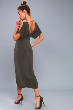 Glamour and grace are at your fingertips when you've got the ASTR the Label Kiera Washed Black Midi Dress! Slinky and slightly shiny jersey knit drapes from a deep V-neck, into split short sleeves and a twisted bodice with knot detail at the waist. Sheath skirt, with center slit, skims your curves down to a midi hem. Deep V-back accented with T-strap detail.
