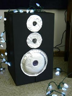 DIY stage speakers: painted cardboard box, paper plates, foil, and glue.