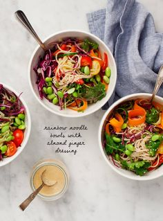 Rainbow Bowls w/ Almond-Ginger Dressing - Heathy vegan & gluten free noodle bowls packed with cucumber, cabbage, kale, carrots & tomatoes. Tossed with a creamy almond-ginger dressing