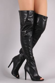 These over-the-knee boots feature a peep toe silhouette, center stitched detail, wrapped stiletto heel, and exposed back-zip closure. Finished with cushioned insole and smooth interior lining. Materia