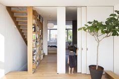 Completed in 2014 in Amsterdam, The Netherlands. Images by Sonia Mangiapane and Peik Li Pang. This is an upwards extension atop an existing two-storeys terrace house located on an artificial island built in the IJ Lake of Amsterdam. Open Living Area, Spacious Living Room, Moving Walls, Narrow House, Interior Stairs, Interior Paint, Ground Floor Plan, House Stairs, Attic Spaces