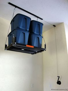 The Garage Gator with a little muscle will raise or lower your most frustrating clutter now sitting on your garage floor up to the ceiling. & Hereu0027s a convenient garage storage solution. This electric motorized ...