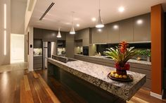 Lennon Brushed Granite as featured on the kitchen bench top of this home completed by Greg Read Architects. Kitchen Tops, Kitchen Ideas, Kitchen Benches, Stone Tiles, Granite Countertops, Natural Stones, Mirror, House, Architects