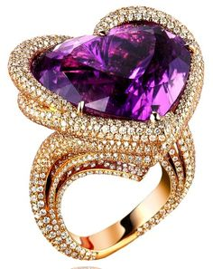 A great and beautiful wedding ring for you ladies out there. A 100% real gold deal. And a Purple Heart shaped 100% REAL diamond.