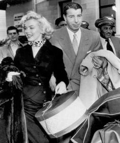 Newlyweds Joe DiMaggio and Marilyn Monroe arrive at the International Airport in this Jan. 29, 1954 photo with plenty of baggage prior to their departure for Tokyo for an extension of their honeymoon. Photo: FILE, AP / AP