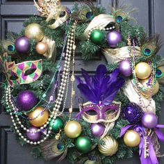 My Mardi Gras Holiday Wreath featured in a Blog.  http://blog.christmaslightsetc.com/decorating/reuse-christmas-ball-ornaments/