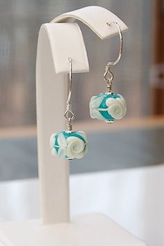 Classic floral lampwork glass hoop earrings.  Lovely lampwork glass is by Heather Davis of Blissful Garden Beads.   Joann Hayssen SRA  $26.00  15% of the purchase price will be donated to Rosemary Farm equine rescue and sanctuary!