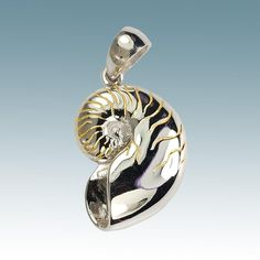 """""""Cat's Eye"""" Shell.  The nautilus shell embodies the classic shape of the golden proportion or golden mean.  This sacred shape is beautifully depicted in rhodium and accent gold plating over sterling silver."""