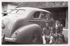 Employees in front of the car company Verkerk en Company in Batavia around 1939 Dutch East Indies by Karin Riper