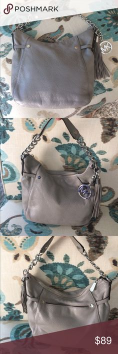Michael Kors gray shoulder bag Michael Kors gray shoulder strap purse in excellent condition. I also have a matching wallet listed as well KORS Michael Kors Bags Shoulder Bags